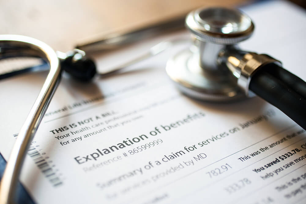 paperwork showing explanation of health benefits hollis laidlaw & simon employment law mount kisco westchester ny and new york city