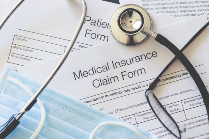 medicaid insurance form with surgical mask and glasses hollis laidlaw & simon mount kisco ny elder law medicaid planning trust & estate planning